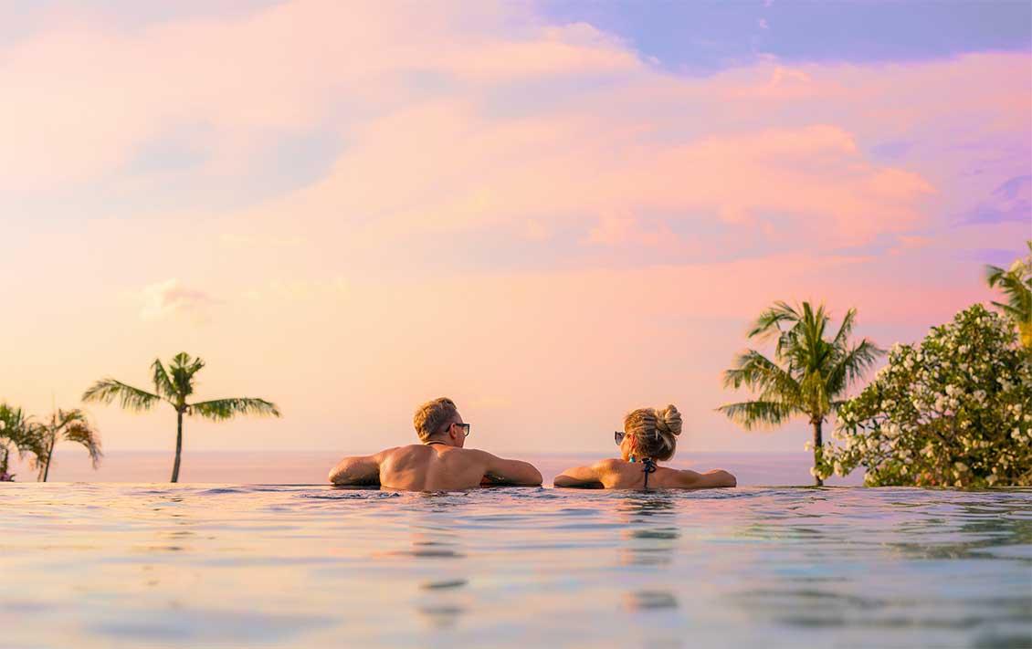 sunset-couple-infinity-swimming-pool